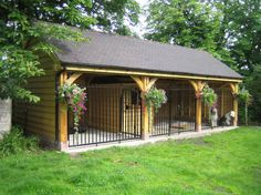 Wowser of an oak car port, workshop and double log store. Sherwood Oak.