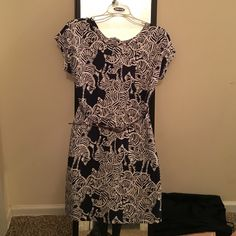 Lilly Pulitzer Dress Absolutely gorgeous Lilly dress! Only worn 2 or 3 times. Very stretchy material so I would say it fits more like a small/medium. Buttons down the back. Price is negotiable within reason! Lilly Pulitzer Dresses Mini