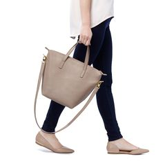 Not too big and not too small. Most people call that medium. We say it's just right. Our Small Carryall Tote functions beautifully as a go-to, everyday essential. Carry it as a satchel or wear it over your shoulder with the detachable strap. We added a gold zipper closure for security — and a touch of elegance. And the best part has to be the strong, substantial Argentine leather. It just gets better with age.