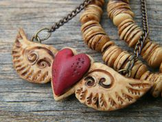 Polymer Clay Inspiration  Try heart & wings with charms instead ~v