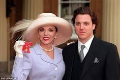 Joan Collins receiving her OBE Buckingham Palace 1997