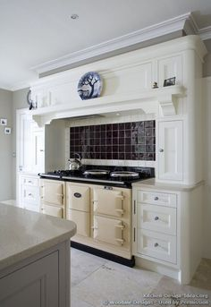 cream aga range cooker and a mantel style range hood Aga Kitchen, Kitchen Tiles, Kitchen Colors, Kitchen Vent, Kitchen Island, Kitchen Cabinets, Cream Country Kitchen, Country Kitchen Designs, Design Kitchen