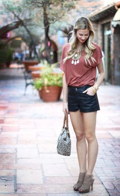 Tshirt and shorts dressed up with a statement necklace and booties