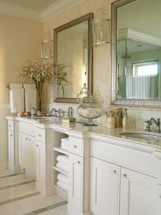 Simplistically Chic Master Bath--his and hers sinks; two personal mirrors in lieu of one large, wall sconces provide lighting; hand towel rack on wall; open storage for extra towels between sinks; extra storage beneath each sink; floral branches & various odds and ends to decorate.