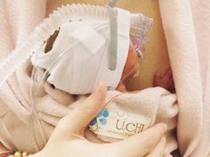 Micro-preemie born at 26 w, 6 days (820 g) using the UCHI kangaroo care garment wrap at 1 week of age. http://www.fb.com/IloveUCHI