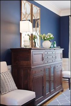 Sideboard from MacKenzie Dow, dining chair from DesignMasters, mirror and lamp from Arteriors
