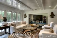 Love the recessed TV nook! Would be great with sliding doors to black it all off if you wanted! Great mix of textures!