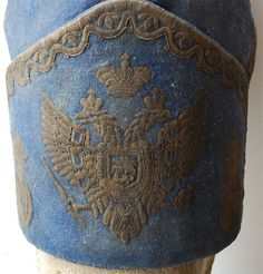 View of the double-headed eagle on the hat of an officer in Russian Dragoon Grenadier regiment from the reign of Peter I, circa 1727-1730.