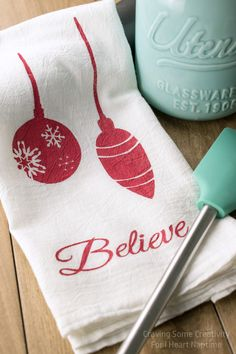 Christmas Stenciled Tea Towels - Free Christmas Silhouette Icons to create stencils Stenciled tea towels with christmas images including jumping reindeer, ornaments, Christmas Tree silhouettes, and text. Files are available in PDF and free silhouette studio cutfiles