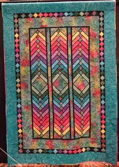 Stained glass jewels in a French Braid quilt style. This is a beautiful quilt with jewel tones set in a stain glass pattern. The sashing and border Bargello Quilts, Batik Quilts, Lap Quilts, Strip Quilts, Patchwork Quilting, Bargello Quilt Patterns, Modern Quilting, Applique Quilts, Quilting Projects