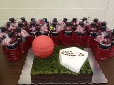 """Jackson's kickball party cake and favors.  Ball and home plate are yellow cake--field is chocolate. Favors are just kickball red powerades with a bag of red """"kickball"""" gumballs attached. Super easy party and the boys had a blast!"""