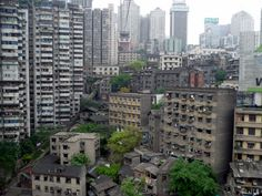 Chongqing, China. Been there-wow! These are tenements you can see next to the Yangtze River, as you travel by cable car over the river.