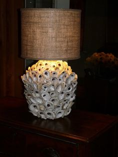 do this with pine cone leaves......Oyster Shell Lamp but with a wider drum shade in white.