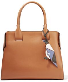 Tan leather (Calf) Snap-fastening tab at open top Designer color  Cognac  Comes with dust bag Weighs approximately Made in Italy 17605af4628