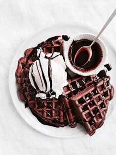 Chocolate waffles for a special breakfast! With ice cream and chocolate sauce