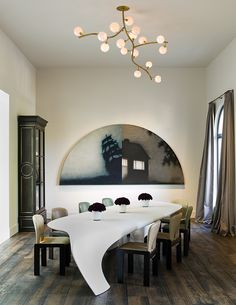 At a home in Atherton, California, interior designer Steven Volpe arranged vintage Roxinho dining chairs by Tobia Scarpa around a Dune table (2007) by Zaha Hadid from David Gill's London gallery. A Zimmerman sculpture hangs above it all. Photo by Pieter Estersohn