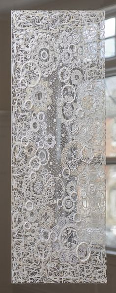 A modern take on the lace curtain - try a random net base with crocheted, appliqués and cutout pieces. Great use for recycling those old and new ends or bits of lace. Reminds me of a Victorian crazy quilt idea..
