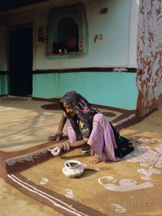 Woman Painting the Wall of a Village House, Tonk Region, Rajasthan, India Photographic
