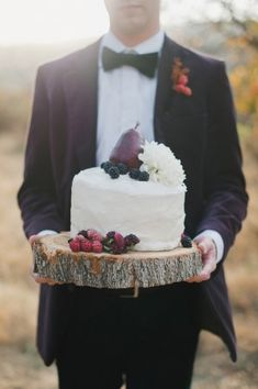 White frosted wedding cake with fruit accent | photography by http://www.raeportraits.com/ and http://etrephotography.blogspot.com/