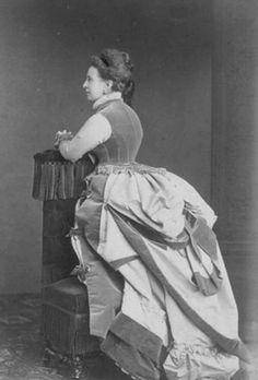"Alexandra ""Sanny"" (Alexandra Iosifovna) (8 Jul 1830-6 Jul 1911) Saxe-Altenburg, Germany (Wife of Grand Duke Konstantin ""Kosti"" Nikolaevich Romanov (21 Sep 1827-25 Jan 1892) Russia) wearing a first bustle period dress in 1874."