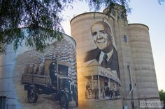 The silos at St James feature Sir George Coles, founder of the Coles chain, who was a local. Tiny Container House, Australian Art, Water Tower, Public Art, Model Trains, In The Heights, Mount Rushmore, The Good Place, Graffiti