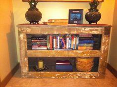 Reclaimed door top with reclaimed barn wood bookcase.