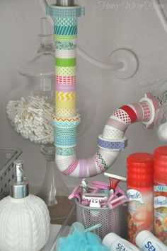 Pretty up the ugly pipe under your sink with washi tape in minutes. Also look at the organization! Under Sink Organization, Sink Organizer, Washi Tape Crafts, Diy Crafts, Washi Tapes, A Thoughtful Place, Decorative Tape, Masking Tape, Home Renovation