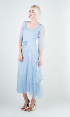 One of our favorites 1920's Vintage Inspired Dresses from Nataya. This beautiful soft robin egg blue gown is available now in sizes S-XL. This color will be retired for 2016 and once its gone its gone. Don't hesitate order yours today! Join our email and receive a 20% discount coupon!