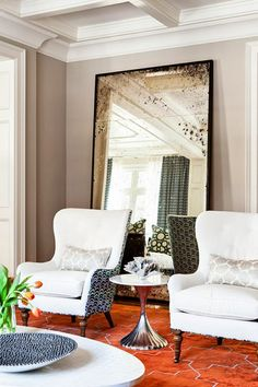 Trending: Upholstered two tone design custom furniture pieces and colored splash area rugs and large scaled floor leaner mirrors!