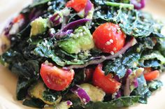 Marinated Kale Salad Recipe Salads with garlic, lemon juice, agave nectar, Himalayan salt, pepper, flaxseed oil, kale, cherry tomatoes, avocado, red cabbage, purple onion, hemp seeds - omit seeds for TLS