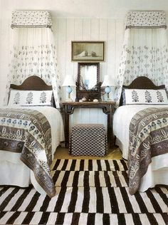Brown and white symmetrical bedroom @Mandy Bryant Bryant Sloan Furniture canopies and beds- NOT the rug