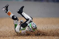 Spain's Niccolo Antonelli glides on the ground after crashing during the Moto 3 race of the French Motorcycling Grand Prix at Le Mans circuit, western France.