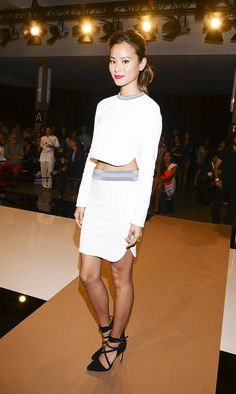Jamie Chung in a white crop top + matching white pencil skirt