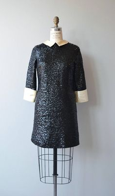 Vintage 1960s super fun black sequin mini dress with white satin collar, wide white satin cuffs on 3/4 sleeves, straight, unfitted shape, satin lining and metal back zipper. --- M E A S U R E M E N T S --- fits like: small/medium bust: 32-36 waist: up to 32 hip: up to 38 length: 38