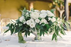 Green, White, and Silver Centerpiece | Carlie Statsky Photography | Classic Hollywood Chic Wedding in Carmel Valley