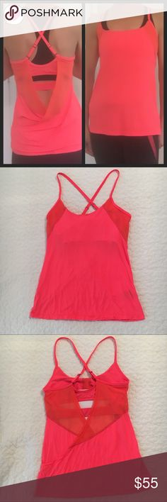 Alala orange (fiery red) tank w/ mesh S Alala orange (fiery red) tank size S.  Adjustable cross in back.  Mesh in front wraps around open back.  Built in bra.  Very slight marks on back mesh shown in last photo although NWOT and never worn. Alala Tops Tank Tops