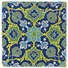 A RARE EARLY OTTOMAN CUERDA SECA POTTERY TILE, TURKEY, FIRST HALF OF 16TH CENTURY decorated in yellow, ultramarine blue, turquoise, green and pale purple, with a symmetrical design based on a central eight-pointed star from which radiate split-palmettes with lotuses at the centre, and clasps and other flowers between, with pairs of half-flowers at the centre of each side