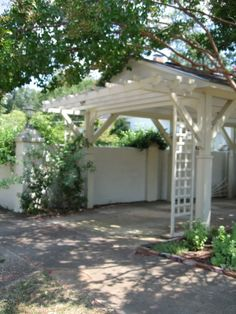 pergola over carport,many more are available http://www.vickswoodworkingplans.com/