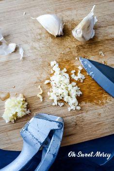 Minced and pressed garlic on a cutting board