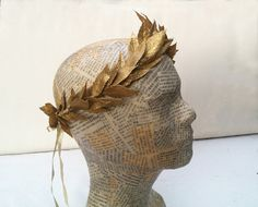~:~ SHIPPING ON ALL ORDERS IN U.S. IS USPS PRIORITY 2-DAY! ~:~ READY TO SHIP! This elegant crown is made from gold leaves that are hand wrapped with a gold ribbon on to a wire frame. A lovely warm gold finish that has a soft sparkle to it! The frame holds it shape nicely, but it is also flexible, so you can move it and adjust it to get a perfect fit. Super light and comfortable to wear. The leaves are made of plastic, so they will never crumble or break. They are very realistic looking…