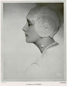The Comtess de Wangen in a spectacular evening cloche, 1928.