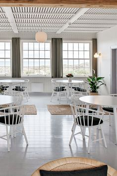 In Northern Jutland lies a beautiful and calm cultural treasure – the seaside hotel, Svinkløv Badehotel. The hotel is known for its tranquil, stress-free ambience, offering scenic views, sublime dining and a classic Scandinavian style that is calm, peaceful and closely connected to the surrounding nature. #fredericiafurniture #j64chair #ejvindajohansson #modernoriginals #craftedtolast Comfortable Dining Chairs, Wood Surface, Stress Free, Scandinavian Style, Painting On Wood, Stools, Seaside, Dining Table, Lounge
