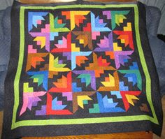 "Dimples ""Butterfly Blooms"" Quilt Kit -- Kit includes the 2.5"" strips for the Twin (76"" x 86"") Sized Quilt  We pre cut all the 2.5"" strips for all colors, black sections, and sashing Fabric for binding also included."