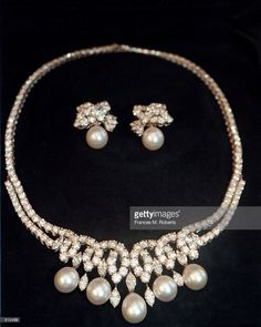 A necklace worn by Princess Diana once on June 3, 1997, created by Asprey & Garrard, jewelers to the Royal Family, is to be auctioned at Guernsey's Auction House on December 16, 1999. The necklace with matching ear rings, known as the Swan Lake Suite, has 164 marquis and brilliant cut diamonds with five large South Sea pearls, the starting bidding is half a million dollars.