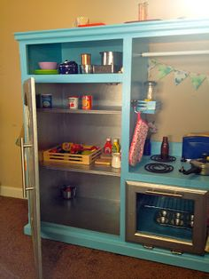 Homemade Kitchen From Entertainment Center | Wooden Melissa & Doug food in the fridge.