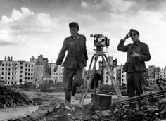 Documenting the destruction. Two German soldiers photograph the destruction of Minsk.
