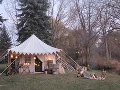 pitching a fantasy tent by the lake...