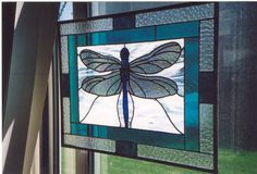 Stained glass dragonfly. Blues. Very pretty.