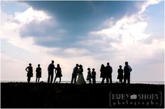 { anna + patrick tie the knot! } { red lion inn } { cohasset, ma } { creative boston wedding photography } | { Ruby Shoes Photography } Creative Boston Wedding Photography, bridal party, storm clouds, silhouette, wedding party, wedding portrait, love this one on the jetty near the lighthouse in scituate by the sea!