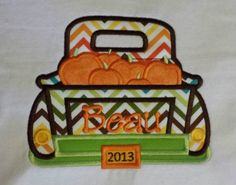 Thanksgiving Truck with Pumpkinsis appliqued directly onto a super soft white bib, bodysuit or t-shirt with your child's name embroidered directly on the applique in your choice of font style. Choose from boy's crew neck t-shirt or girl's lettuce edge t-shirt. Leave information in boxes below.